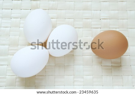a lot of white and brown eggs - stock photo