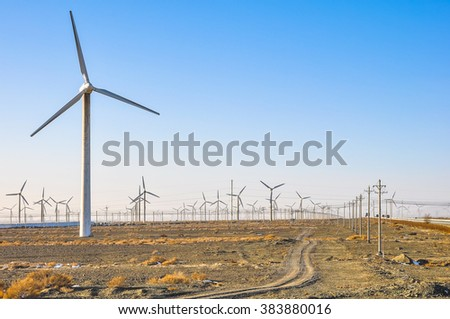 A lot of wind generators in the field. - stock photo