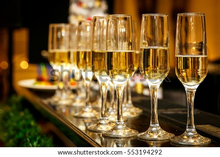 A lot of wine glasses with a cool delicious champagne or white wine at the event catering