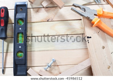 A lot of work tools scattered over wooden planks - stock photo