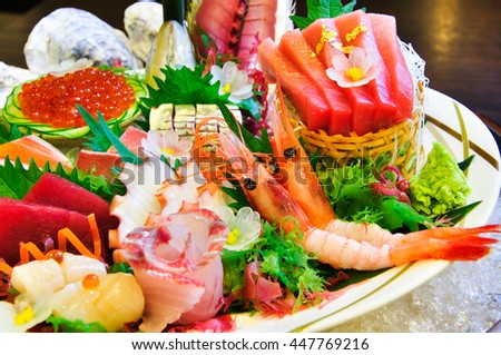 A lot seafood sashimi luxury raw food Japanese style on ice.