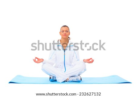 A lotus position in practise of yoga - on white background - stock photo