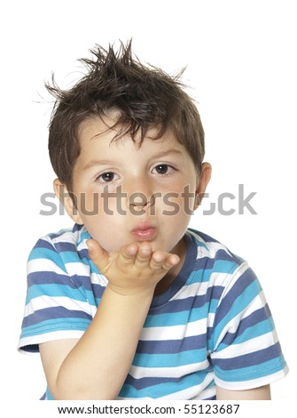 A lovely child blowing a kiss and looking directly to camera