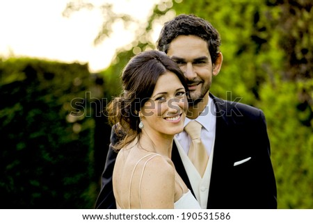 A lovely couple enjoying a very special joy moment during their wedding day, Barcelona, Spain. - stock photo