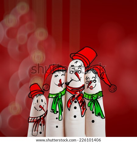A lovely family hand drawn and finger of snowmen on blur background as concept idea - stock photo
