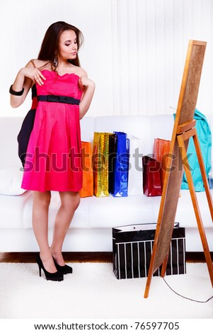 A lovely girl trying on new dress - stock photo
