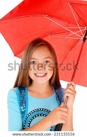 A lovely little girl standing isolated for white background holding a red umbrella.  - stock photo