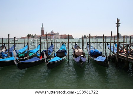 A lovely picture of the architecture of Venice ( Italy ) with canals, gondolas.