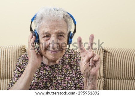 a lovely senior woman listening music - stock photo