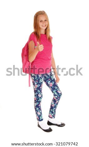 A lovely slim young girl with her backpack on her back standing for whitebackground, smiling and ready to go to school. - stock photo