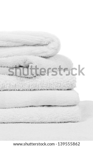 A lovely stack of white bathroom towels isolated on a white background - stock photo