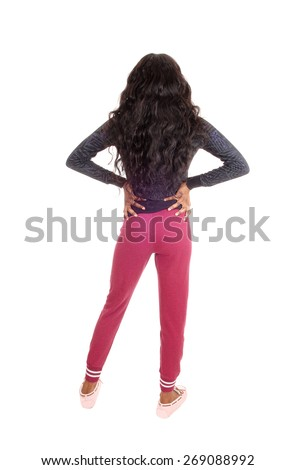 A lovely tall young African American woman in pink tights and long curly