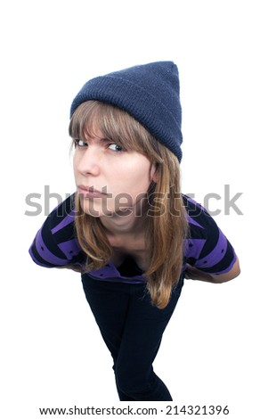 A lovely teenage girl in casual wardrobe, high angle with intentional distortion.  Isolated on a white background with generous copyspace.  - stock photo