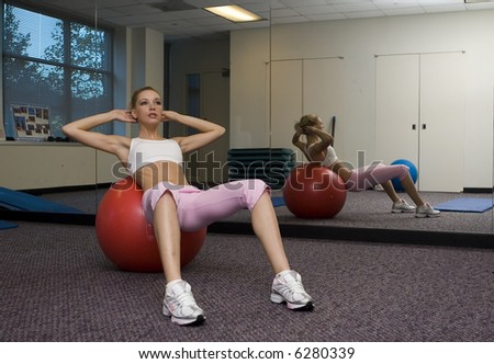 A lovely young blonde woman working out