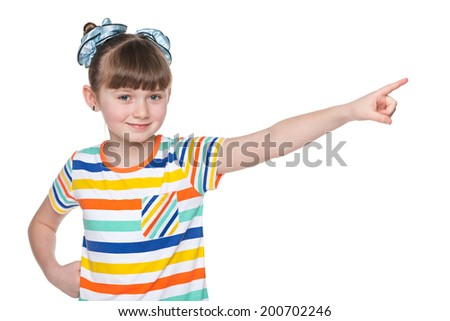 A lovely young girl shows her finger to the side - stock photo