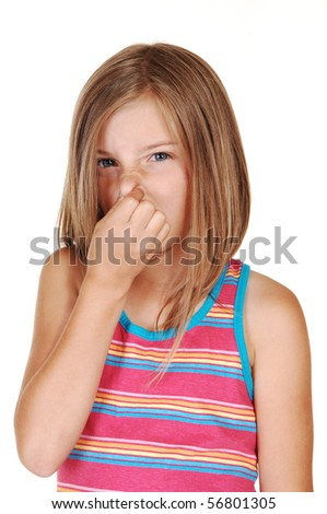 A lovely young girl with blond hair holds her nose closed for the smell in front of her, for white background. - stock photo