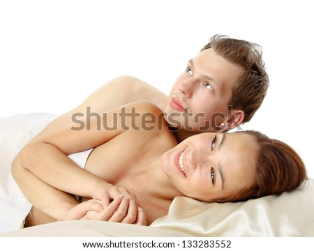 A loving affectionate nude heterosexual couple on the bed - stock photo