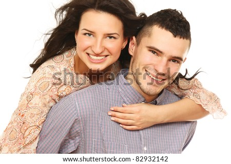 A loving young couple isolated on white background - stock photo