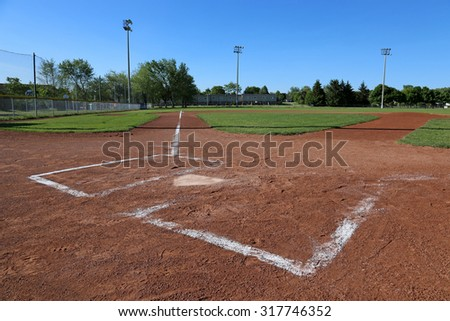 A low angle shot of a baseball field.  - stock photo