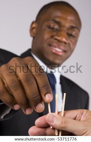 A lucky business man choosing a straw - Focus on the hands