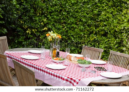 A lunch table in the garden - stock photo