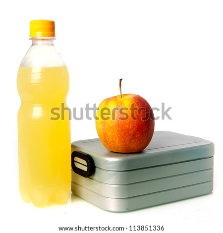 a lunchbox, with an apple and juice
