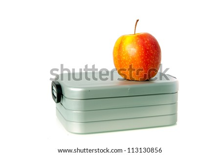 a lunchbox, with an apple on a white background