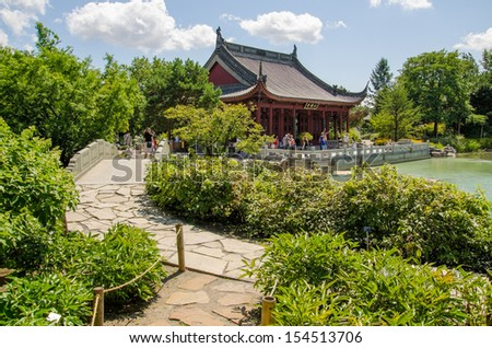 A lush Chinese garden with beautiful plants and architecture
