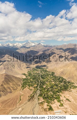 A lush valley irrigated by a river in the rough mountain in Ladakh, India - stock photo