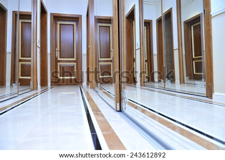 A luxurious hallway with doors to a private home. - stock photo