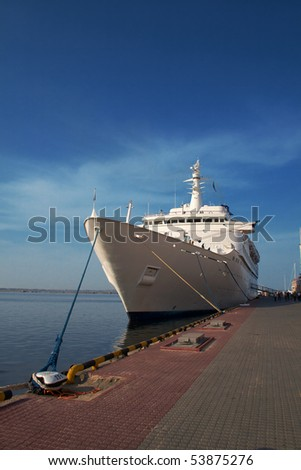 A luxury cruise ship docked in the port - stock photo