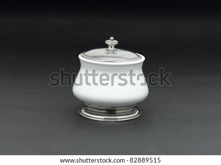 A luxury porcelain sugar bowl with a pewter lid for tea or coffee time - stock photo