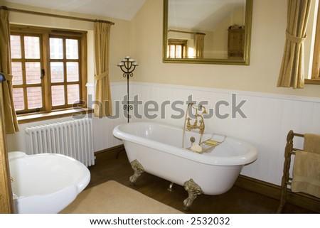 A luxury traditional bathroom - stock photo