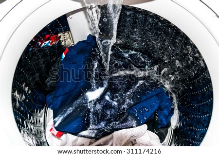 A machine for washing clothes, bed linens, etc.. - stock photo