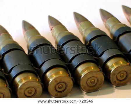 A machine-gun bullet belt - stock photo