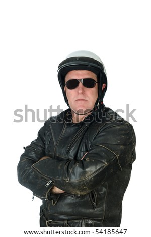A macho motorcycle rider posing while wearing his leather jacket, white helmet and sun glasses. - stock photo
