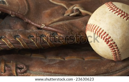 a macro of a baseball in glove