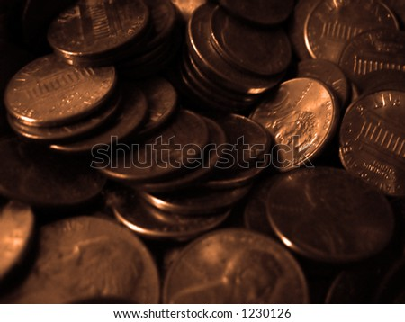A macro of a pile of copper pennies. - stock photo