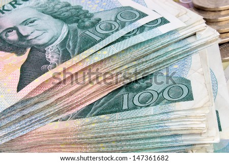 A macro photograph of a stack of Swedish 100 Kroner banknotes.  - stock photo