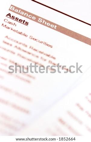 "A macro shot of a balance sheet document. Focus on ""balance sheet"". - stock photo"