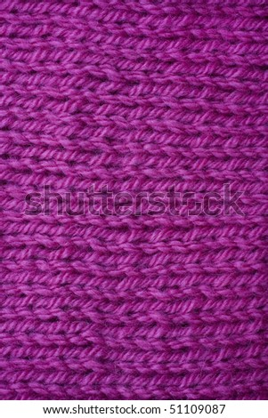 A macro shot of a bright pink purl background - stock photo