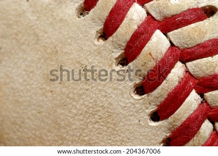 A macro shot of a somewhat used baseball. - stock photo