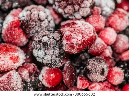 A macro shot of some frozen fruit berries.