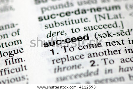 """A macro shot of the word """"Succeed"""" from the dictionary - stock photo"""