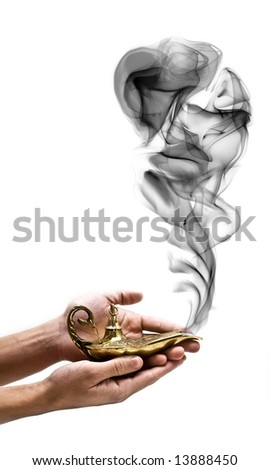A magic genie lamp on a persons hand, isolated on white. - stock photo
