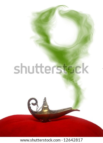 A magical genie lamp with smoke on a red velvet pillow with circular, green smoke. - stock photo