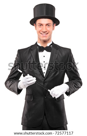 A magician holding a magic wand and posing isolated against white background