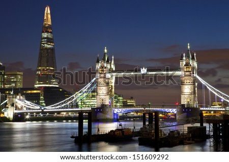 A magnificent view of Tower Bridge, the Shard and the River Thames in London. - stock photo