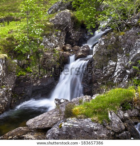 A magnificent waterfall in the Scottish back country.  - stock photo