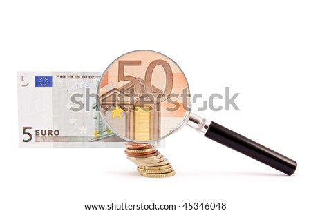 A magnifying glass turns a 5 euro note into a 50 one. - stock photo